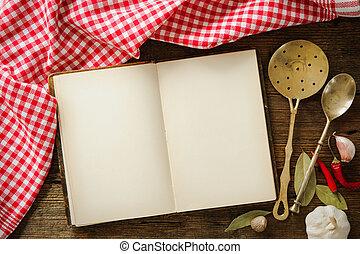Libro de cocina abierto con utensilios de cocina