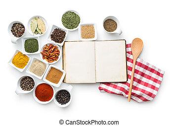 Libro de cocina en blanco y varias especias.
