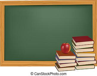 Libros escolares con manzana