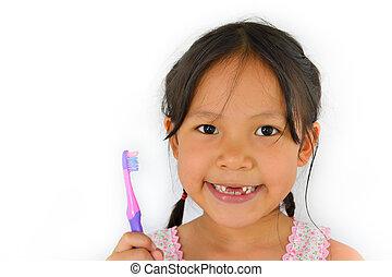 Linda chica asiática y cepillo de dientes de Tailand Sudeste Asia