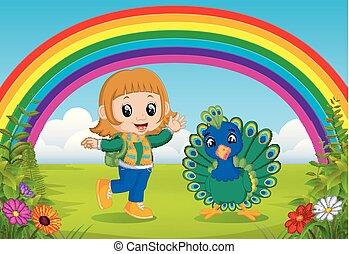 Linda chica y pavo real en el parque con la escena del arco iris