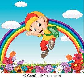 Lindo chico en un jardín de flores con arco iris