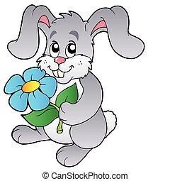 Lindo conejito sosteniendo flores