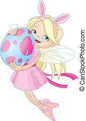 Lindo hada volando con huevo de Pascua