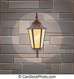 Linterna en la pared de piedra