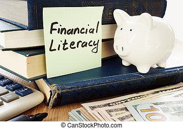 Literatura Financiera escrita en un palo y una alcancía como símbolo de ahorro.