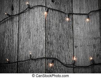Luces de Navidad blanca con un fondo rústico de madera
