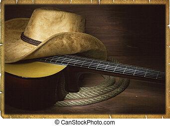 Música country americana con guitarra y ropa de vaquero