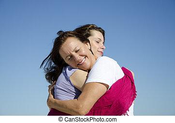 Madre e hija mostrando amor y afecto