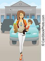 Madre llevando a su hijo y bolsas de supermercado