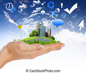 Mano humana sosteniendo una ciudad verde