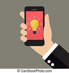 Mano sosteniendo smartphone con Bombilla en exhibición