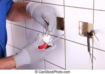 Manos de electricista