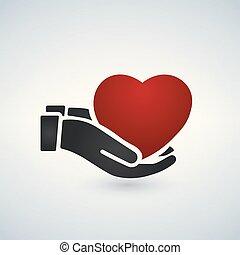 Manos saludables sosteniendo el corazón rojo