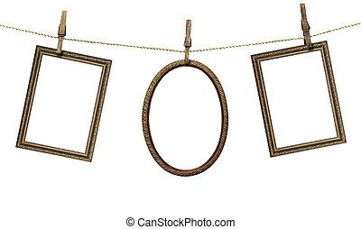 marco, tres, aislado, plano de fondo, ahorcadura, blanco, clothespins