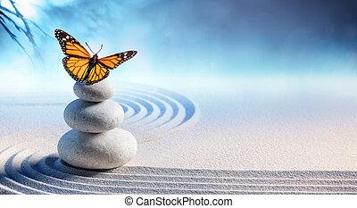 Mariposa sobre piedras de masaje en el spa en el jardín zen