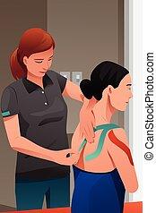 Masaje terapista herido en el hombro