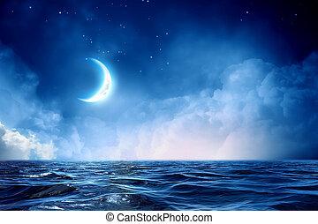 Media luna en el cielo estrellado