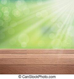 Mesa de madera sobre fondo borroso verde