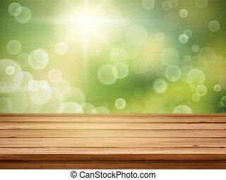 Mesa de madera sobre fondo de naturaleza verde borrosa