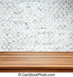 Mesa de madera sobre pared de ladrillo blanco