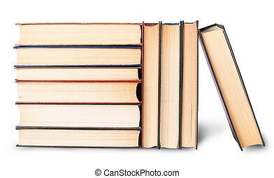 Montones verticales y horizontales de libros viejos