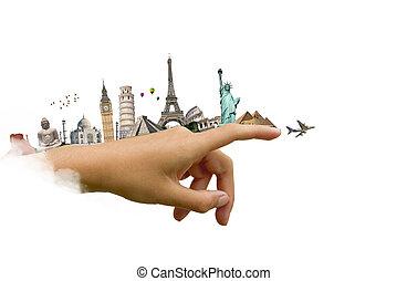 Monumentos del mundo en una mano de mujer