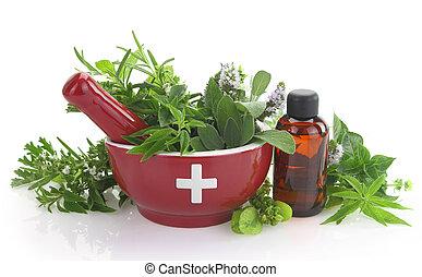 Mortar con cruz medicinal, hierbas frescas y una botella de aceite esencial