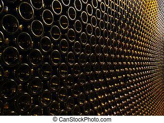Muchas botellas de vino apiladas