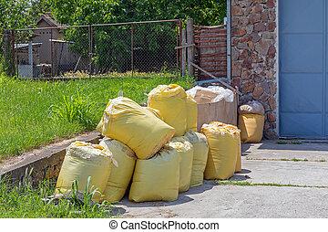 muchos, amarillo, sacos