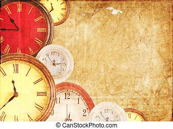 Muchos relojes en un fondo de papel
