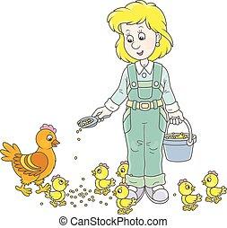 Mujer avícola alimentando pollos