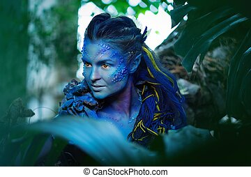 Mujer Avatar en un bosque mágico