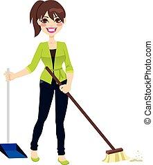 Mujer barriendo piso