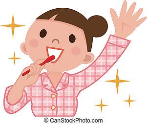 Mujer cepillando dientes