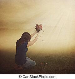 Mujer con el corazón roto.