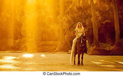 Mujer con vestido medieval a caballo