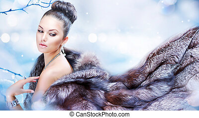 Mujer de invierno con abrigo de piel de lujo