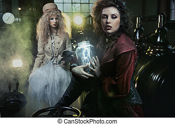 Mujer de la vieja moda con un frasco de rayos