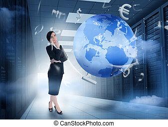 Mujer de negocios en el centro de datos con gráficos de la tierra y de la moneda