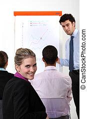 Mujer de negocios en un entrenamiento profesional