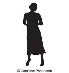 Mujer de pie. falda larga, manos en bolsillos. Silueta vectorial aislada