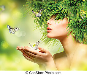Mujer de primavera. Chica de verano con pelo de hierba y maquillaje verde