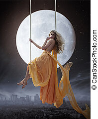 Mujer elegante sobre un gran fondo lunar