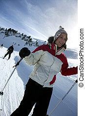 Mujer esquiando