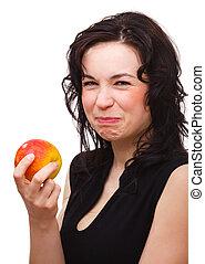 mujer, manzana, después, cara, agrio, elaboración, morder