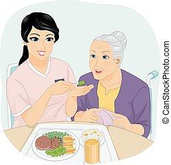 Mujer mayor comida de enfermera