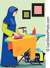 Mujer musulmana planchando ropa en casa