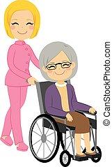 Mujer paciente mayor en silla de ruedas