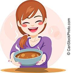 Mujer sirviendo comida